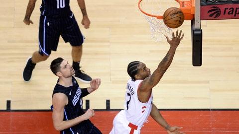 <p>               Toronto Raptors forward Kawhi Leonard (2) scores on a layup past Orlando Magic center Nikola Vucevic (9) during the second half of Game 2 of an NBA basketball first-round playoff series Tuesday, April 16, 2019, in Toronto. (Nathan Denette/The Canadian Press via AP)             </p>