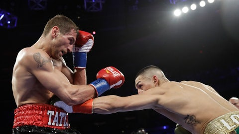 <p>               Teofimo Lopez, right, punches Finland's Edis Tatli during the third round of a NABF lightweight championship boxing match Saturday, April 20, 2019, in New York. Lopez stopped Tatli in the fifth round. (AP Photo/Frank Franklin II)             </p>