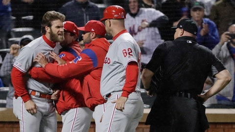 <p>               Philadelphia Phillies' Bryce Harper, left, is restrained while arguing with umpire Mark Carlson, right, during the fourth inning of a baseball game against the New York Mets, Monday, April 22, 2019, in New York. (AP Photo/Frank Franklin II)             </p>