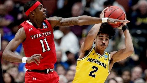 <p>               Michigan guard Jordan Poole, right, looks to pass the ball as Texas Tech forward Tariq Owens defends during the first half an NCAA men's college basketball tournament West Region semifinal Thursday, March 28, 2019, in Anaheim, Calif. (AP Photo/Jae C. Hong)             </p>