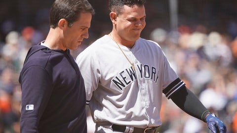 <p>               New York Yankees' Gio Urshela, right, is taken out of a baseball game by a trainer after being hit with a throw by San Francisco Giants pitcher Nick Vincent during the fifth inning Sunday, April 28, 2019, in San Francisco. (AP Photo/Tony Avelar )             </p>