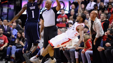 <p>               Toronto Raptors forward Kawhi Leonard (2) falls backward as he makes a 3-point basket, next to Orlando Magic forward Jonathan Isaac (1) during the second half of Game 2 of an NBA basketball first-round playoff series Tuesday, April 16, 2019, in Toronto. (Frank Gunn/The Canadian Press via AP)             </p>