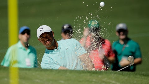 <p>               Tiger Woods hits out of the bunker on the second hole during a practice round for the Masters golf tournament Wednesday, April 10, 2019, in Augusta, Ga. (AP Photo/Charlie Riedel)             </p>