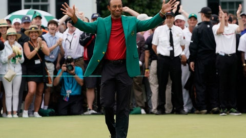 <p>               Tiger Woods celebrates after he won the Masters golf tournament Sunday, April 14, 2019, in Augusta, Ga. (AP Photo/David J. Phillip)             </p>