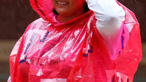 <p>               A fan waits out a rain delay before a baseball game between the Oakland Athletics and the Texas Rangers, Saturday, April 13, 2019, in Arlington, Texas. The Rangers delayed the start time of Saturday's game due to inclement weather. (AP Photo/Sam Hodde)             </p>