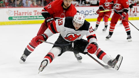 <p>               Carolina Hurricanes' Nino Niederreiter (21), of the Czech Republic, and New Jersey Devils' Nico Hischier (13), of Switzerland, chase the puck during the second period of an NHL hockey game in Raleigh, N.C., Thursday, April 4, 2019. (AP Photo/Gerry Broome)             </p>