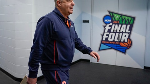 <p>               Auburn head coach Bruce Pearl walks to a news conference after a practice session for the semifinals of the Final Four NCAA college basketball tournament, Thursday, April 4, 2019, in Minneapolis. (AP Photo/David J. Phillip)             </p>