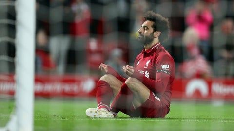 <p>               Liverpool's Mohamed Salah sits in front of the goal after scoring his side's fifth goal during the English Premier League soccer match between Liverpool and Huddersfield Town at Anfield Stadium, in Liverpool, England, Friday, April 26, 2019.(AP Photo/Jon Super)             </p>