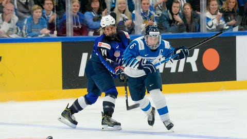 <p>               Brianna Decker, left, of the United States and Jenni Hiirikoski of Finland vie for the puck during the IIHF Women's Ice Hockey World Championships final match between the United States and Finland  in Espoo, Finland, Sunday, April 14, 2019. (Mikko Stig/Lehtikuva via AP)             </p>