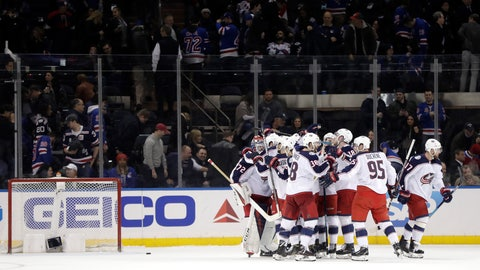 <p>               Columbus Blue Jackets swarm goaltender Sergei Bobrovsky, left, of Russia, after he made three saves during the shootout against the New York Rangers during an NHL hockey game Friday, April 5, 2019, in New York. The Blue Jackets won 3-2. (AP Photo/Julio Cortez)             </p>