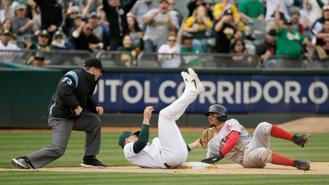 Laureano nails another Red Sox runner, Athletics win