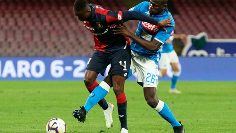 <p>               Genoas CFC forward Kauma, left, tries to keep the ball against SSC Napoli's defender Kalidou Koulibaly during an Italian Serie A soccer match at the San Paolo stadium in Naples, Italy, Sunday, April 7, 2019. (Cesare Abbate/ANSA via AP)             </p>
