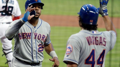 <p>               New York Mets' Dominic Smith, left, is met by Jason Vargas (44) after scoring during the first inning of a baseball game against the Miami Marlins, Tuesday, April 2, 2019, in Miami. (AP Photo/Lynne Sladky)             </p>