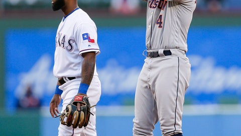 <p>               Texas Rangers second baseman Danny Santana, left, looks away as Houston Astros' George Springer (4) celebrates a double during the first inning of a baseball game Friday, April 19, 2019, in Arlington, Texas. (AP Photo/Brandon Wade)             </p>