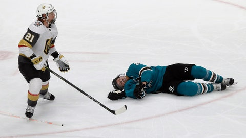<p>               San Jose Sharks center Joe Pavelski, right, lies on the ice next to Vegas Golden Knights center Cody Eakin during the third period of Game 7 of an NHL hockey first-round playoff series in San Jose, Calif., Tuesday, April 23, 2019. (AP Photo/Jeff Chiu)             </p>