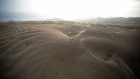 """<p>               FILE - In this Jan. 16, 2019 photo, competitors ride their motorbikes across the dunes during stage nine of the Dakar Rally in Pisco, Peru. Dakar organizers say next year's cross-country race will be held in """"the deep and mysterious deserts of the Middle East, in Saudi Arabia."""" (AP Photo/Ricardo Mazalan, File)             </p>"""