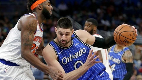<p>               Orlando Magic's Nikola Vucevic, right, drives to the basket against New York Knicks' Mitchell Robinson during the second half of an NBA basketball game Wednesday, April 3, 2019, in Orlando, Fla. (AP Photo/John Raoux)             </p>