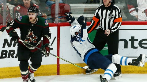 <p>               Arizona Coyotes defenseman Kevin Connauton (44) sends Winnipeg Jets center Jack Roslovic (28) into referee Chris Lee during the third period of an NHL hockey game Saturday, April 6, 2019, in Glendale, Ariz. The Jets defeated the Coyotes 4-2. (AP Photo/Ross D. Franklin)             </p>