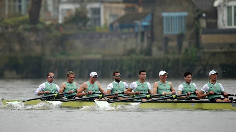 <p>               Cambridge rowing crew, with left James Cracknell, 2nd left, in action against Oxford during The Boat Race on the River Thames in London, Sunday April 7, 2019.  The 165th annual Boat Race traditionally fought out between Oxford and Cambridge university rowing crews. (Adam Davy/PA via AP)             </p>