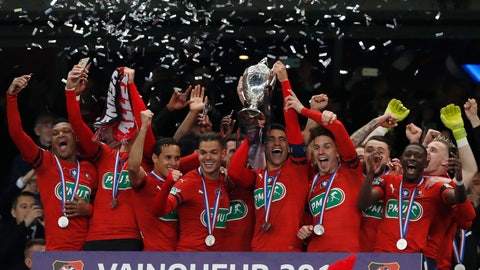 <p>               Players of Rennes celebrate with trophy after winning the French Cup soccer final between Rennes and Paris Saint Germain at the Stade de France stadium in Saint-Denis, outside Paris, France, Saturday, April 27, 2019. (AP Photo/Thibault Camus)             </p>