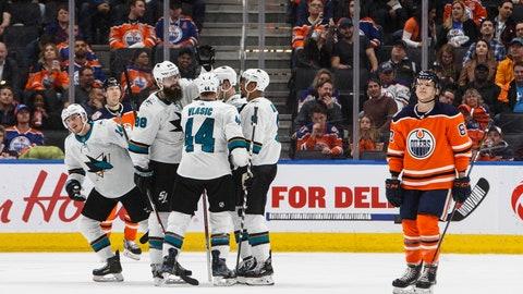 <p>               San Jose Sharks celebrate a goal as Edmonton Oilers' Matthew Benning (83) skates past during the second period of an NHL hockey game Thursday, April 4, 2019, in Edmonton, Alberta. (Jason Franson/The Canadian Press via AP)             </p>