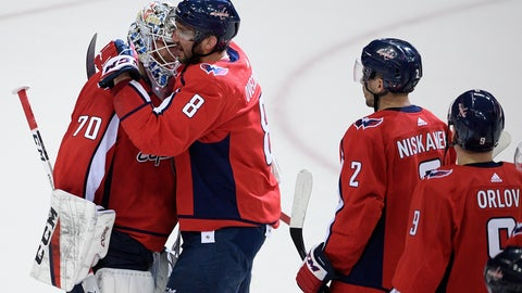 <p>               Washington Capitals left wing Alex Ovechkin (8), of Russia, celebrates with goaltender Braden Holtby (70) after Game 5 of an NHL hockey first-round playoff series against the Carolina Hurricanes, Saturday, April 20, 2019, in Washington. Also seen are Matt Niskanen (2) and Dmitry Orlov (9), of Russia. The Capitals won 6-0. (AP Photo/Nick Wass)             </p>