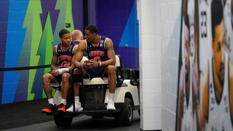 <p>               Auburn's Horace Spencer (0) and J'Von McCormick get a ride on a golf cart after a practice session for the semifinals of the Final Four NCAA college basketball tournament, Thursday, April 4, 2019, in Minneapolis. (AP Photo/David J. Phillip)             </p>