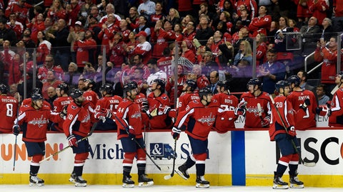 <p>               Washington Capitals Lars Eller (20) and his line mates are congratulated after Eller scored a goal during the first period of their NHL hockey game against the Montreal Canadiens in Washington, Thursday, April 4, 2019. The Capitals beat the Canadiens, 2-1. (AP Photo/Susan Walsh)             </p>