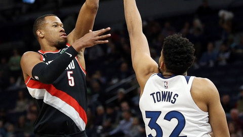 <p>               Portland Trail Blazers' Rodney Hood, left, shoots over Minnesota Timberwolves' Karl-Anthony Towns in the first half of an NBA basketball game Monday April 1, 2019, in Minneapolis. (AP Photo/Stacy Bengs)             </p>