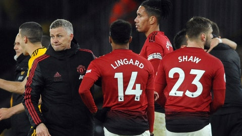 <p>               Manchester United manager Ole Gunnar Solskjaer, left, talks with players Jesse Lingard, Chris Smalling and Luke Shaw, from left to right, at the end of the English Premier League soccer match between Wolverhampton Wanderers and Manchester United at the Molineux Stadium in Wolverhampton, England, Tuesday, April 2, 2019. Wolverhampton won 2-1. (AP Photo/Rui Vieira)             </p>
