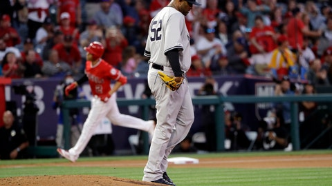 <p>               New York Yankees starting pitcher CC Sabathia, center right, walks off the mound after giving up a solo home run to Los Angeles Angels' Andrelton Simmons, background left, during the first inning of a baseball game Wednesday, April 24, 2019, in Anaheim, Calif. (AP Photo/Marcio Jose Sanchez)             </p>