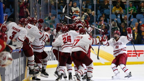 <p>               Massachusetts players celebrate a 4-3 victory in overtime against Denver during the semifinals of the men's Frozen Four NCAA hockey tournament Thursday, April 11, 2019, in Buffalo, N.Y. (AP Photo/Jeffrey T. Barnes)             </p>