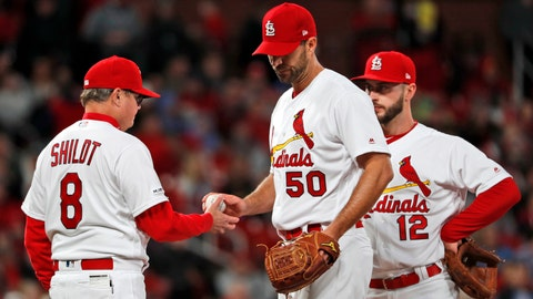 St. Louis Cardinals starting pitcher Adam Wainwright (50) is removed by manager Mike Shildt (8) as shortstop Paul DeJong (12) watches during the fourth inning of the team's baseball game against the New York Mets Friday, April 19, 2019, in St. Louis. (AP Photo/Jeff Roberson)