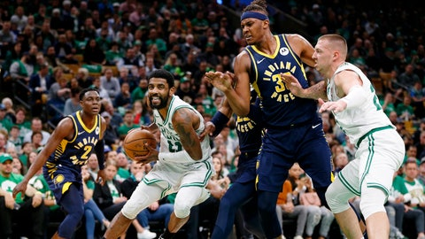 Apr 17, 2019; Boston, MA, USA; Boston Celtics guard Kyrie Irving (11) drives while center Daniel Theis (27) sets a block on Indiana Pacers center Myles Turner (33) during the second half in game two of the first round of the 2019 NBA Playoffs at TD Garden. Mandatory Credit: Greg M. Cooper-USA TODAY Sports