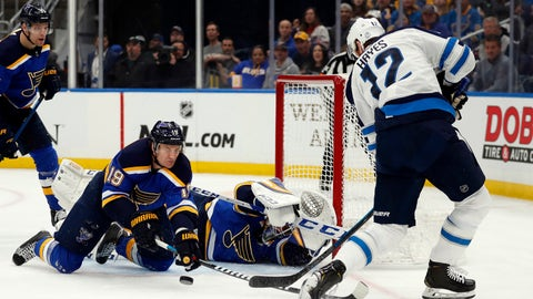 Winnipeg Jets' Kevin Hayes (12) is unable to score past past St. Louis Blues' Jay Bouwmeester (19) and goaltender Jordan Binnington during the first period in Game 3 of an NHL first-round hockey playoff series Sunday, April 14, 2019, in St. Louis. (AP Photo/Jeff Roberson)