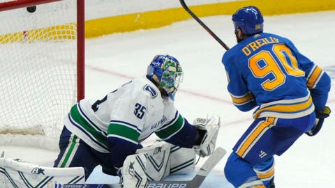 St. Louis Blues' Ryan O'Reilly (90) scores in a shootout against Vancouver Canucks' Thatcher Demko (35) in an NHL hockey game, Saturday, April 6, 2019, in St. Louis. (AP Photo/Bill Boyce)
