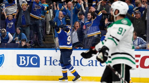 Fans and St. Louis Blues' Vladimir Tarasenko, center, celebrate a goal by Tarasenko as Dallas Stars' Tyler Seguin (91) looks on during the second period in Game 1 of an NHL second-round hockey playoff series Thursday, April 25, 2019, in St. Louis. (AP Photo/Jeff Roberson)