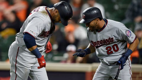 Minnesota Twins Nelson Cruz, left, is congratulated by Eddie Rosario after his two-run home run against the Baltimore Orioles in the first inning of the second game of a baseball doubleheader, Saturday, April 20, 2019, in Baltimore. (AP Photo/Gail Burton)