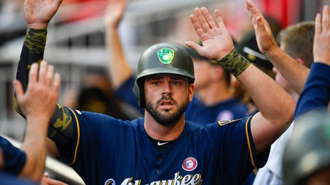 <p>               Milwaukee Brewers' Mike Moustakas celebrates in the dugout after scoring on a Jesus Aguilar single to center field during the first inning of the team's baseball game against the Atlanta Braves, Saturday, May 18, 2019, in Atlanta. (AP Photo/John Amis)             </p>