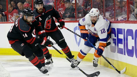 <p>               Carolina Hurricanes' Justin Williams (14) takes the puck from New York Islanders' Josh Bailey (12) while Hurricanes' Justin Faulk (27) looks on at rear during the first period of Game 4 of an NHL hockey second-round playoff series in Raleigh, N.C., Friday, May 3, 2019. (AP Photo/Gerry Broome)             </p>