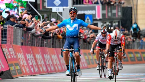 <p>               Richard Carapaz of Ecuador celebrates as he crosses the finish line to win the 4th stage of the Giro d'Italia, tour of Italy cycling race, from Orbetello to Frascati, Tuesday, May 14, 2019. Richard Carapaz of Ecuador sprinted to victory in the fourth stage of the Giro d'Italia on Tuesday, while Slovenian cyclist Primoz Roglic kept the overall lead after avoiding a crash toward the end of the route. (Alessandro Di Meo/ANSA via AP)             </p>