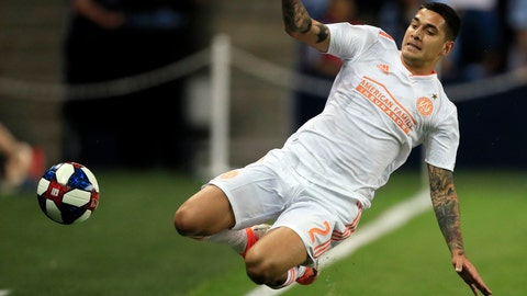 <p>               Atlanta United defender Franco Escobar (2) tries to keep the ball in bounds during the first half of an MLS soccer match against Sporting Kansas City in Kansas City, Kan., Sunday, May 5, 2019. (AP Photo/Orlin Wagner)             </p>