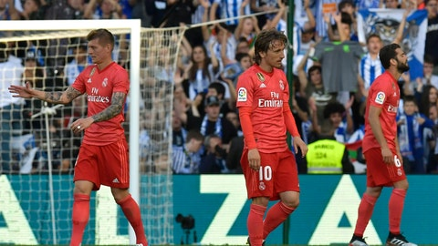 <p>               Real Madrid's Toni Kroos, left, Real Madrid's Luka Modric, centre, and Real Madrid's Nacho Fernandez walk on the pitch in dejection at the end of the Spanish La Liga soccer match between Real Sociedad and Real Madrid, at Anoeta stadium, in San Sebastian, northern Spain, Sunday, May 12, 2019. (AP Photo/Alvaro Barrientos)             </p>