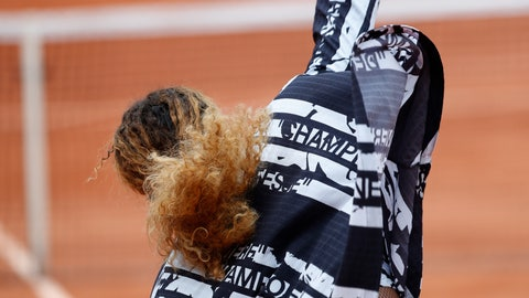 """<p>               Serena Williams of the U.S. takes off her jacket with French text reading """"Champion"""", """"Queen"""", """"Godess"""", and """"Mother"""" after warming up prior to her first round match of the French Open tennis tournament against Vitalia Diatchenko of Russia at the Roland Garros stadium in Paris, Monday, May 27, 2019. (AP Photo/Pavel Golovkin)             </p>"""
