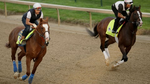 <p>               Kentucky Derby entrants Improbable, left, and War of Will run during a workout at Churchill Downs Wednesday, May 1, 2019, in Louisville, Ky. (AP Photo/Charlie Riedel, File)             </p>