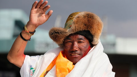 <p>               FILE - In this May 20, 2018, file photo, Nepalese veteran Sherpa guide, Kami Rita, 48, waves as he arrives in Kathmandu, Nepal. Rita has scaled Mount Everest for a 23rd time, breaking his own record for the most successful ascents of the world's highest peak. (AP Photo/Niranjan Shrestha, File)             </p>