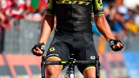 <p>               Esteban Chavez of the Mitchelton-Scott team celebrates while crossing the finish line in San Martino di Castrozza to win the 151 km, 19th stage of the Giro d'Italia cycling race from Treviso to San Martino di Castrozza. (Alessandro Di Meo/ANSA via AP)             </p>