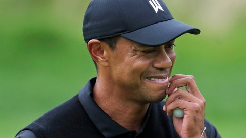 <p>               Tiger Woods reacts as he walks off the 7th green during the second round of the PGA Championship golf tournament, Friday, May 17, 2019, at Bethpage Black in Farmingdale, N.Y. (AP Photo/Julio Cortez)             </p>