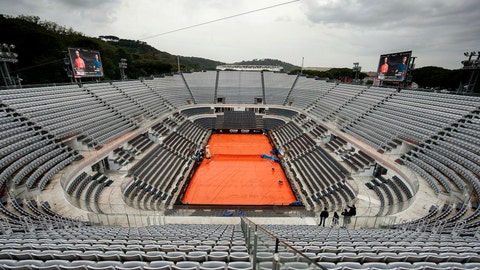 <p>               The central court is covered as all the matches are temporarily suspended due to the rain at the Italian Open tennis tournament in Rome, Wednesday, May 15, 2019. (Riccardo Antimiani/ANSA via AP)             </p>