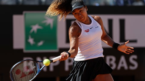<p>               Japan's Naomi Osaka returns the ball during her match against Slovakia's Dominika Cibulkova at the Italian Open tennis tournament, in Rome, Thursday, May, 16, 2019. (AP Photo/Gregorio Borgia)             </p>